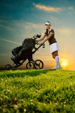 Female golfer with golf bag. Female golfer standing next golf bag Royalty Free Stock Image