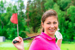 Female golfer with a golf club Royalty Free Stock Photos