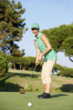 Female Golfer On Golf Course. Putting On Green Royalty Free Stock Photography