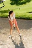 Female Golfer Hitting Ball Royalty Free Stock Images