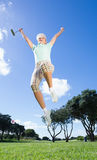 Female golfer leaping and cheering Royalty Free Stock Photos