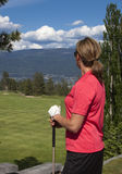 Female Golfer Looking at Golf Course Royalty Free Stock Photography