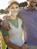 Female Golfer With Male Friend Royalty Free Stock Photography