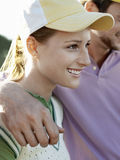 Female Golfer With Male Friend Royalty Free Stock Image