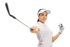 Female golfer pointing a golf club and holding a ball Stock Photography