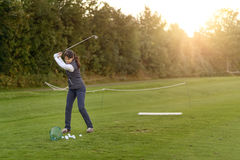 Female golfer practicing on a driving range Royalty Free Stock Photos