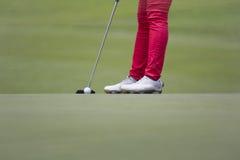 Female golfer putting Stock Photo
