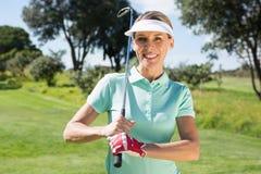 Female golfer smiling at camera Royalty Free Stock Photo