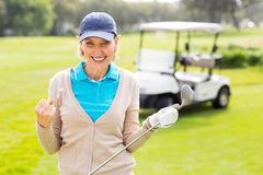 Female golfer smiling at camera. On a sunny day at the golf course Stock Photo