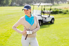 Female golfer smiling with hands on hip Royalty Free Stock Photos