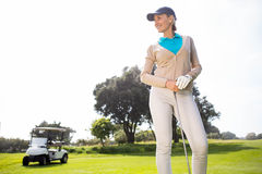 Female golfer smiling and posing Royalty Free Stock Photo