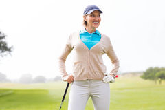 Female golfer standing with hand on hip Royalty Free Stock Photo