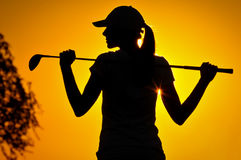 Female golfer at sunrise Stock Photos