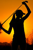 Female golfer at sunrise Royalty Free Stock Photos