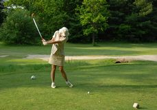 Female golfer tee-off Stock Photo