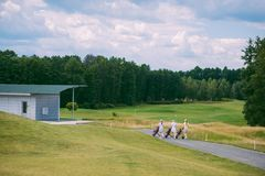 female golfers with golf gear walking at golf course stock photography