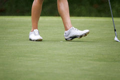 Female golfers walking on green Stock Photos
