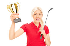 Female golfing champion holding a trophy. Isolated on white background royalty free stock photography