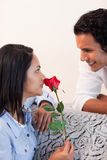 Female got a rose from her boyfriend Stock Image