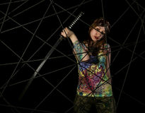 Female gothic warrior in pilot old glasses posing with katana sword Royalty Free Stock Image