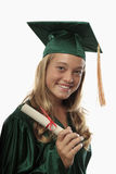 Female graduate in cap and gown Stock Images
