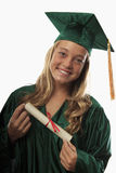Female graduate in cap and gown Stock Image