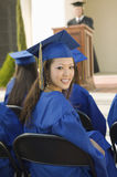 Female Graduate With Friends Attending Graduation Ceremony Royalty Free Stock Photography