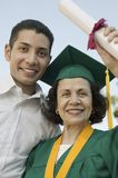 Female Graduate With Her Son Holding Degree Royalty Free Stock Images