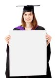Female graduate holding a ad Royalty Free Stock Photos