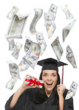 Female Graduate Holding $100 Bills with Many Falling Around Her Royalty Free Stock Photo