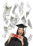Female Graduate Holding $100 Bills with Many Falling Around Her Stock Image