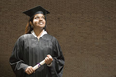 Female graduate holding a diploma Stock Image
