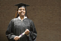 Female graduate holding her diploma Royalty Free Stock Photo