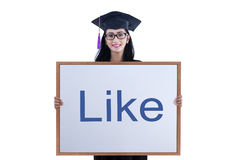 Female graduate holding like board on white Stock Photo