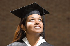 Female graduate looking up Royalty Free Stock Photo