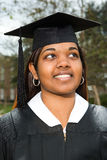 Female graduate looking up Stock Photography