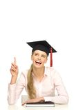 Female graduate pointing up Royalty Free Stock Photography