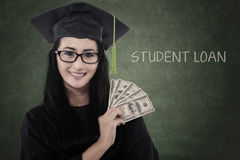 Female graduate student get money for loan. Asian female graduate get student loan , posing in a classroom Royalty Free Stock Photo