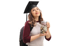 Female graduate student holding a jar filled with money. And looking up isolated on white background Stock Image