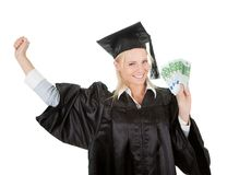 Female graduate student holding money Royalty Free Stock Photos
