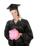 Female graduate student holding piggybank Royalty Free Stock Photo