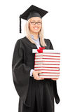 Female graduate student holding a stack of books Stock Photo
