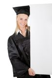 Female graduate student presenting empty board Royalty Free Stock Photo
