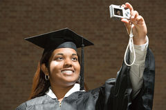 Female graduate taking a self portrait Royalty Free Stock Photography