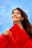 Female graduate throwing the mortarboard Royalty Free Stock Image