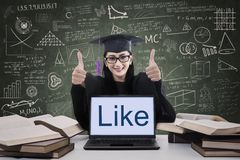 Female graduate thumbs up Stock Images