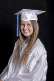 Female Graduate in White Cap & Gown Stock Images