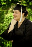 Female Graduating. A young female graduating college stock images