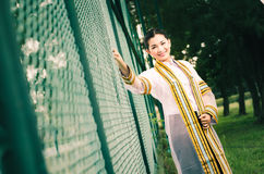The female graduation portrait in academic gown is looking forwa Royalty Free Stock Photos