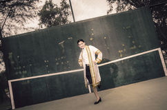 The female graduation portrait in academic gown is looking forwa Royalty Free Stock Photography